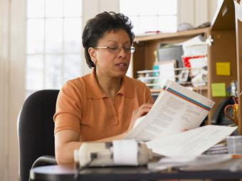 Woman reading insurance policy.