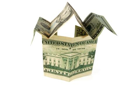 Dollar folded into a house