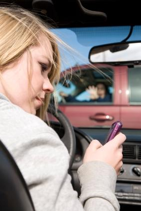 Teen driver texting and about to collide