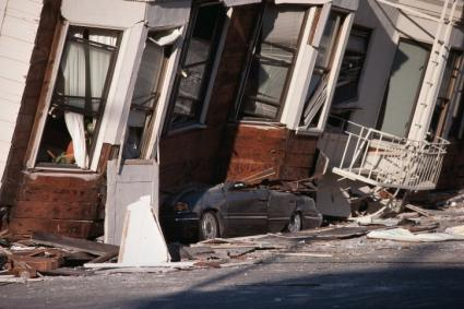 Row houses with earthquake damage