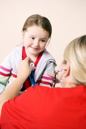 Doctor examining girl