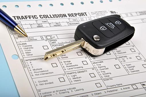 car key and crash report