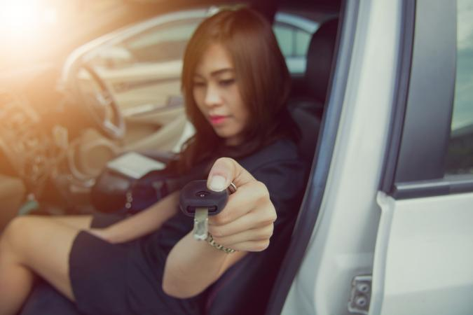 Woman handing over car key