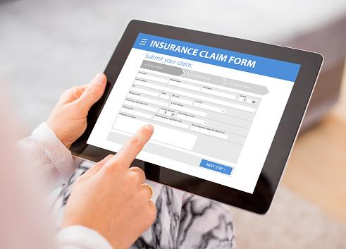 Life Insurance claim form on table