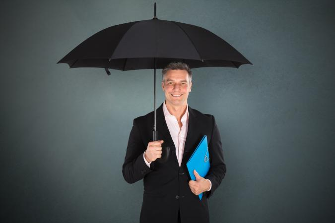 insurance agent under blue umbrella