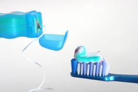 Image of dental floss, toothbrush and toothpaste