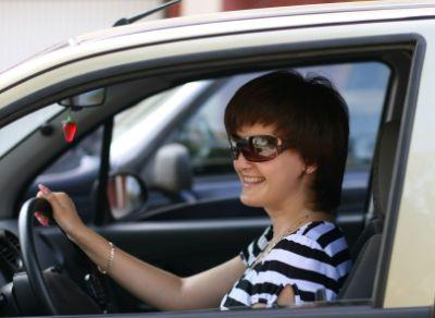 Woman excited about lowering her car insurance rates