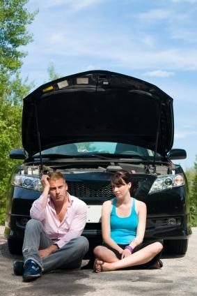 Couple by broken down car.