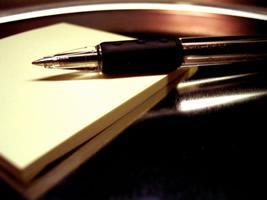 A pen atop a scratch-paper pad