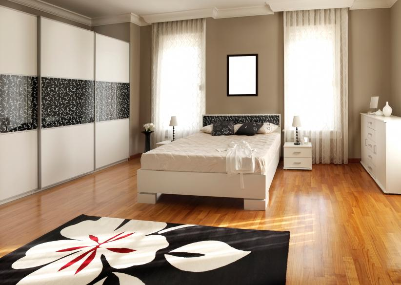 Bedroom With Black Rug
