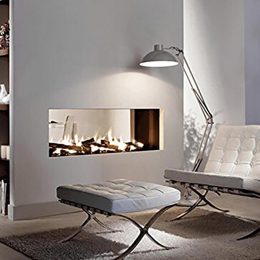 https://cf.ltkcdn.net/interiordesign/images/slide/234180-850x850-7-barcelona-chair-fireplace.jpg