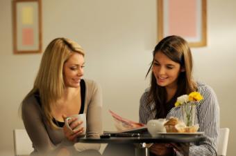 Two women reading a design magazine