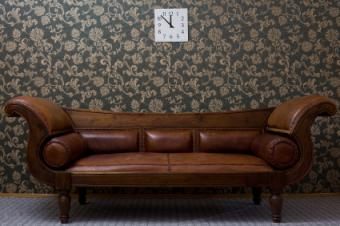 Couch against floral wallpaper