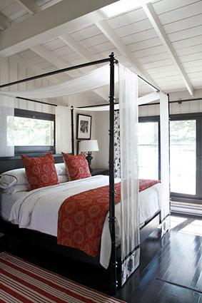 draped panels on a four poster bed frame