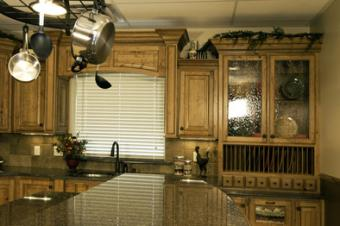 Wooden kitchen cabinets with seeded glass doors