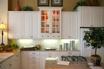 White lighted glass kitchen cabinets