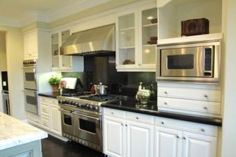 White kitchen cabinets with clear glass doors