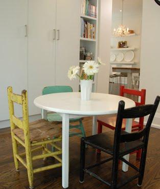 Mismatched chairs at table by Sarah Richardson Design (Design Inc., 2008)