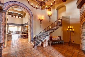 Spanish style Mediterranean staircase and foyer