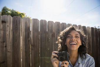 woman holding camera outside