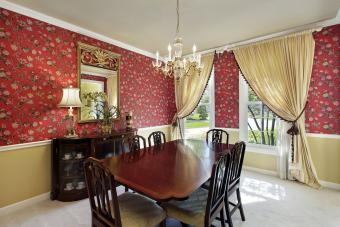 Red flowered wallpaper in dining room