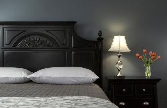 Black Painted Bed in Modern Bedroom Interior