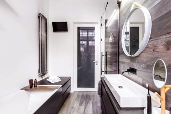 Small, bright bathroom in modern design with wooden style tiles