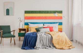 bedroom with rainbow colored headboard