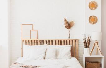 wooden headboard against a light colored wall