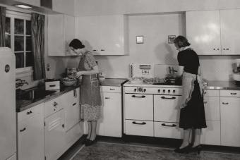Two women making dinner in the 1940's