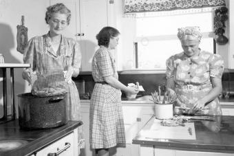 Women in kitchen preparing food, circa 1945
