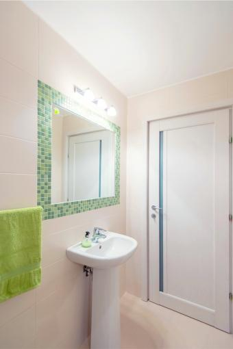Modern bathroom decorated in green and cream colors