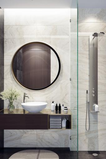 Small luxurious minimalist bathroom with round mirror