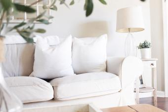 White Sofa By Table At Home