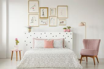 Feminine bedroom interior with posters