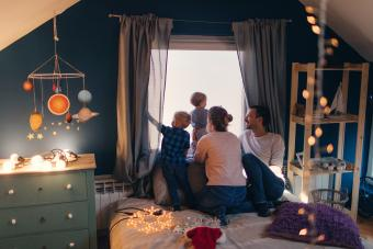 Family with two children bedroom astronomy decoration