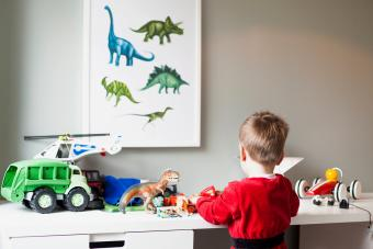 Boy playing with toys in his room