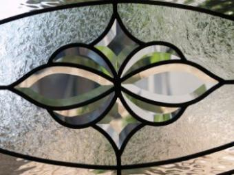 Etched, carved and beveled glass doors.