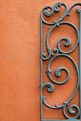 wrought iron against terra-cotta colored stucco