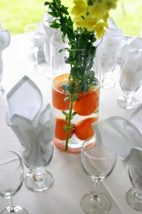 centerpiece with citrus fruit and flowers