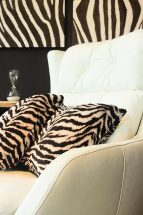 Room with zebra print wallpaper and accent pillows