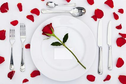 Valentines Day table setting white with rose petals