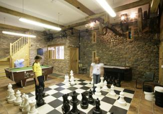 game room with giant chess set