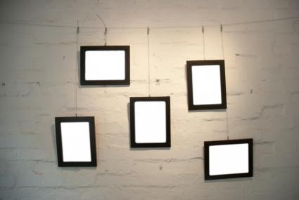 Arranging and grouping wall pictures lovetoknow for Hang photos from wire