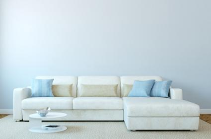 Low couch with blue walls