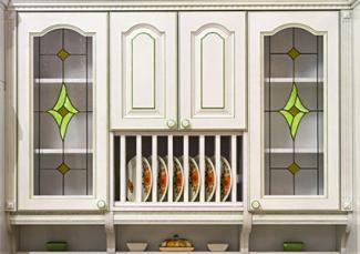 White retro cabinets with stained glass doors