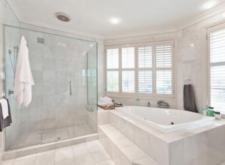 Bathroom with marble tile floors and walls