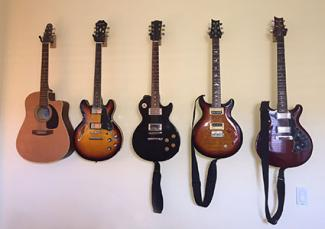 Guitar collection hanging on wall