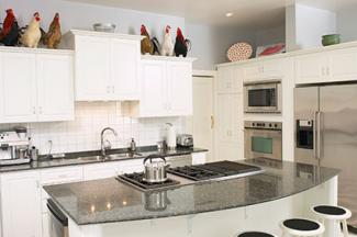 Rooster collection on kitchen cabinets