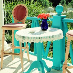 Terrace with bright colored furniture